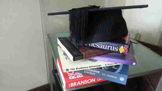 Image of books and graduation hat