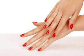 Image of hands with red nails