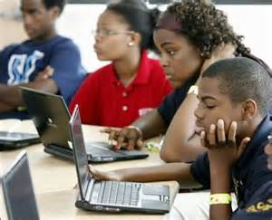 Imageof students using laptops